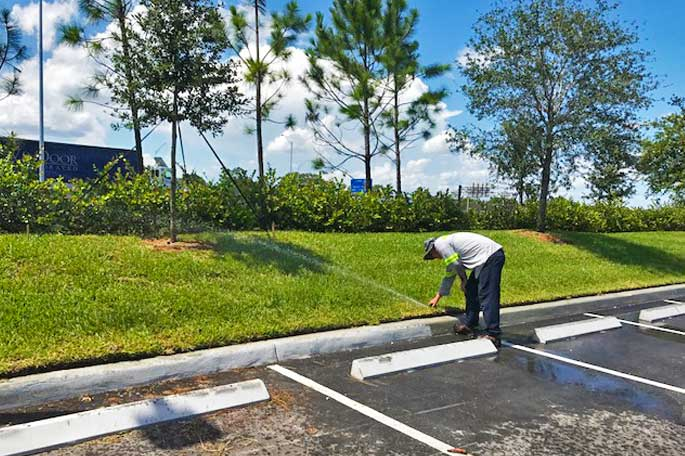 Irrigation system being tested along parking lot in Sunrise, FL.