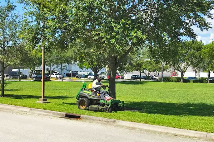 Commercial property in Davie, FL being mowed by our team member.